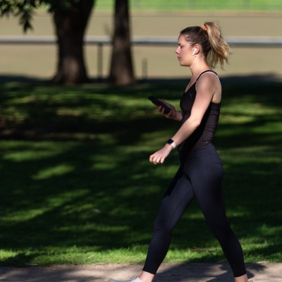 A young woman is seen exercising in Princes Park during COVID-19 in Melbourne, Australia. Victoria records 5 new cases and three deaths as restrictions are slightly eased. This comes just days after Health Minister Jenny Mikakos resigned over the Hotel Quarantine bungle and as pressure mounts for the Premier, Daniel Andrews, to resign. As the Spring weather sees warmer days, more Melbournians are simply ignoring the rules.