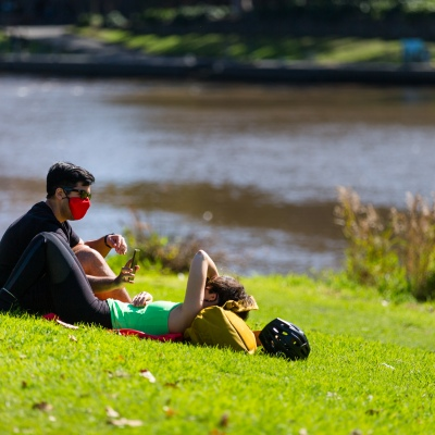 A couple enjoy the sun on the Yarra Banks. Spring has arrived as Melbournians declare 'crisis' over as they venture out of their homes in huge numbers to enjoy the sun despite Premier Daniel Andrews pleading them to stay indoors during COVID-19 in Melbourne, Australia. Premier Daniel Andrews is said to have struck a deal with the cross benchers allowing his controversial plans for extending the State of Emergency for a further 12 months. This comes as new COVID-19 infections dropped below 100 for the first time since the second wave began, however daily deaths still remain high and show no sign of declining.
