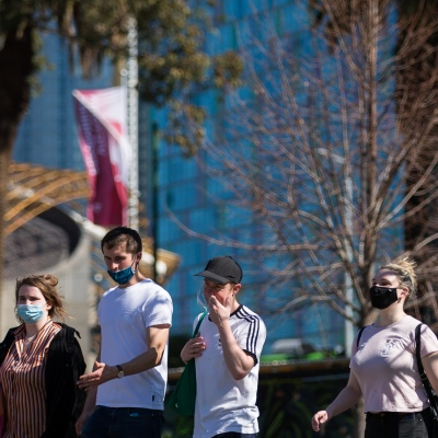 A group of people are seen wearing masks but not physically distancing. Spring has arrived as Melbournians declare 'crisis' over as they venture out of their homes in huge numbers to enjoy the sun despite Premier Daniel Andrews pleading them to stay indoors during COVID-19 in Melbourne, Australia. Premier Daniel Andrews is said to have struck a deal with the cross benchers allowing his controversial plans for extending the State of Emergency for a further 12 months. This comes as new COVID-19 infections dropped below 100 for the first time since the second wave began, however daily deaths still remain high and show no sign of declining.