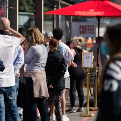 People line up for coffee ignoring social distancing rules. Spring has arrived as Melbournians declare 'crisis' over as they venture out of their homes in huge numbers to enjoy the sun despite Premier Daniel Andrews pleading them to stay indoors during COVID-19 in Melbourne, Australia. Premier Daniel Andrews is said to have struck a deal with the cross benchers allowing his controversial plans for extending the State of Emergency for a further 12 months. This comes as new COVID-19 infections dropped below 100 for the first time since the second wave began, however daily deaths still remain high and show no sign of declining.