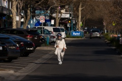 A woman wearing a face shield walks in the middle of the road on Church Street Brighton during COVID-19 in Melbourne, Australia.  Premier Daniel Andrews announced today that he may release plans to open up the state next Sunday amid speculation that Stage 4 restrictions will be extended.