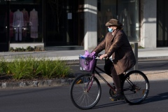 A man wearing a facemask and a hat rides on Church Street Brighton during COVID-19 in Melbourne, Australia.  Premier Daniel Andrews announced today that he may release plans to open up the state next Sunday amid speculation that Stage 4 restrictions will be extended.