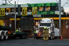 A large transport truck is seen reversing towards the crash scene. A truck has hit an overhead rail bridge on Albert Road , Albert Park resulting in emergency services arriving at the scene.