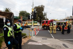 A truck has hit an overhead rail bridge on Albert Road , Albert Park resulting in emergency services arriving at the scene.