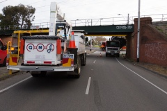 A mobile crane sits waiting to assist in removing a truck which struck the Albert Road Bridge on Monday evening. A truck has hit an overhead rail bridge on Albert Road , Albert Park resulting in emergency services arriving at the scene.