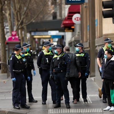 A large group of police are seen in the CBD during COVID-19 in Melbourne, Australia. In just 24 hours, Melbourne will fall into the imposition of the full effect of Daniel Andrews Stage 4 COVID-19 restrictions. Retailers, services, construction and many more will trade for the last time tomorrow before being forced to close for at least the next 6 weeks with many unlikely to ever reopen again. This comes as 439 new cases were uncovered overnight along with 13 deaths all of which were patients at aged care facilities.