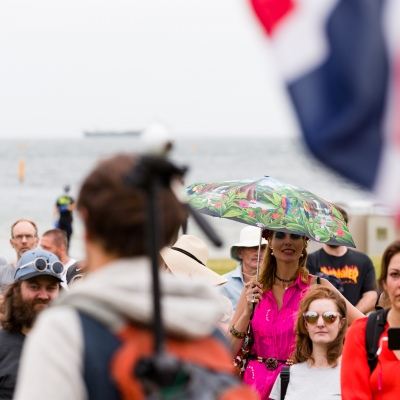 A woman holding an umbrella is seen amongst the protester's during the Sack Daniel Andrews Protest in St Kilda. Parts of the community are looking to hold the Victorian Premier accountable for the failings of his government that led to more than 800 deaths during the Coronavirus crisis. Victoria has recorded 36 days Covid free as pressure mounts on the Premier Daniel Andrews to relax all remaining restrictions.
