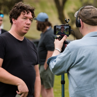 Well known Libertarian and documentary filmmaker, Topher Field is seen being interviewed during the Sack Daniel Andrews Protest in St Kilda. Parts of the community are looking to hold the Victorian Premier accountable for the failings of his government that led to more than 800 deaths during the Coronavirus crisis. Victoria has recorded 36 days Covid free as pressure mounts on the Premier Daniel Andrews to relax all remaining restrictions.