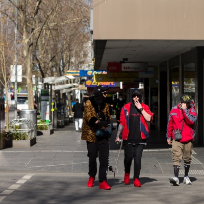 Three skaters are seen walking the near empty streets in the CBD during COVID-19 in Melbourne, Australia. Stage 4 restrictions continue in Melbourne as work permits come into effect at midnight today. This comes as a further 471 new COVID-19 cases were uncovered overnight.