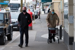 Locals wearing masks are seen walking on the main street amid fears of an outbreak spreading during COVID-19 in Kilmore, Australia. An outbreak which started in Chadstone in Melbourne, has spread as far as Benalla. Twenty-eight people linked to the outbreak have now tested positive for COVID-19. There are now two confirmed cases in Kilmore linked with a Melbourne Resident who carried the virus into the town. The person visited the Odd Fellows Cafe in Kilmore which lead to him spreading the virus to a staff member, and a customer. The cafe has been closed for deep cleaning and will remain closed until the 19th October.