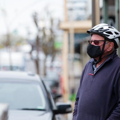 A man wearing a mask stands at a crossing during COVID-19 in Kilmore, Australia. An outbreak which started in Chadstone in Melbourne, has spread as far as Benalla. Twenty-eight people linked to the outbreak have now tested positive for COVID-19. There are now two confirmed cases in Kilmore linked with a Melbourne Resident who carried the virus into the town. The person visited the Odd Fellows Cafe in Kilmore which lead to him spreading the virus to a staff member, and a customer. The cafe has been closed for deep cleaning and will remain closed until the 19th October.