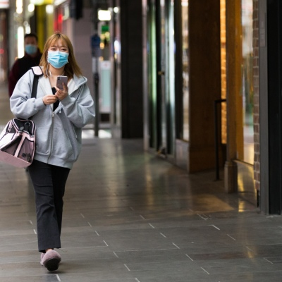 A woman wearing a mask in a rare sighting of life in the CBD during COVID-19 in Melbourne, Australia. Stage 4 restrictions continue in Melbourne as life drains away from the city now that work permits are being enforced. Premier Daniel Andrews once again failed to answer questions on his administrations failures that led to over 180 deaths in his state. Victoria recorded a further 450 new COVID-19 infections along with 11 deaths overnight.