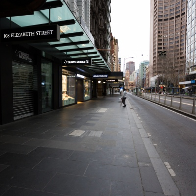 A view of Elizabeth Street with a single person visible during what would usually be peak hour during COVID-19 in Melbourne, Australia. Stage 4 restrictions continue in Melbourne as life drains away from the city now that work permits are being enforced. Premier Daniel Andrews once again failed to answer questions on his administrations failures that led to over 180 deaths in his state. Victoria recorded a further 450 new COVID-19 infections along with 11 deaths overnight.