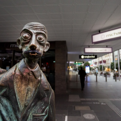 A startled looking street statue witnesses the city devoid of human activity during COVID-19 in Melbourne, Australia. Stage 4 restrictions continue in Melbourne as life drains away from the city now that work permits are being enforced. Premier Daniel Andrews once again failed to answer questions on his administrations failures that led to over 180 deaths in his state. Victoria recorded a further 450 new COVID-19 infections along with 11 deaths overnight.