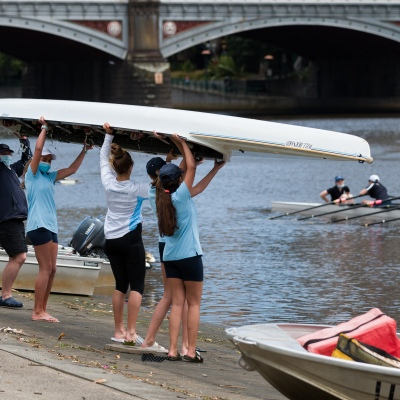 School girls are seen lifting their four over their heads after rowing during the COVID-19 in Melbourne. With over a week of zero cases in Victoria, Premier Daniel Andrews is expected to make major announcements on Sunday about further easing of restrictions.