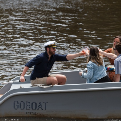 Friends are seen clinking beers on a boat on The Yarra during the COVID-19 in Melbourne. With over a week of zero cases in Victoria, Premier Daniel Andrews is expected to make major announcements on Sunday about further easing of restrictions.