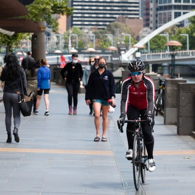 A man is seen riding his bicycle along The Yarra during the COVID-19 in Melbourne. With over a week of zero cases in Victoria, Premier Daniel Andrews is expected to make major announcements on Sunday about further easing of restrictions.