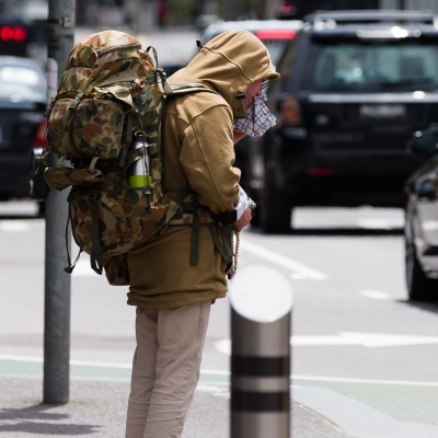 A man wearing  a large backpack is seen in the CBD during the COVID-19 in Melbourne. With over a week of zero cases in Victoria, Premier Daniel Andrews is expected to make major announcements on Sunday about further easing of restrictions.