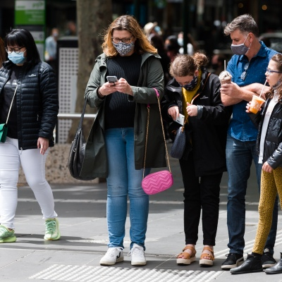 A family is seen waiting at the traffic lights during the COVID-19 in Melbourne. With over a week of zero cases in Victoria, Premier Daniel Andrews is expected to make major announcements on Sunday about further easing of restrictions.