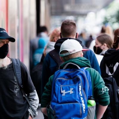 A man with a white beard looks on as locals walk by in the CBD during the COVID-19 in Melbourne. With over a week of zero cases in Victoria, Premier Daniel Andrews is expected to make major announcements on Sunday about further easing of restrictions.