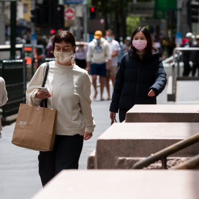 A woman walks by H&N in the CBD during the COVID-19 in Melbourne. With over a week of zero cases in Victoria, Premier Daniel Andrews is expected to make major announcements on Sunday about further easing of restrictions.