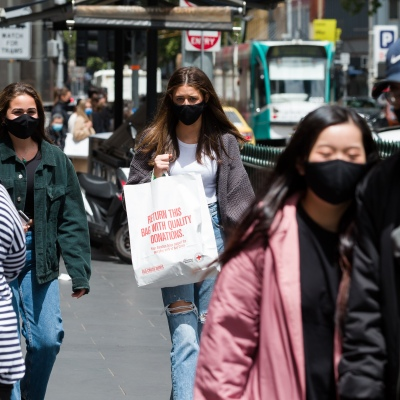 Two woman walk together as shoppers flock back to the CBD during the COVID-19 in Melbourne. With over a week of zero cases in Victoria, Premier Daniel Andrews is expected to make major announcements on Sunday about further easing of restrictions.