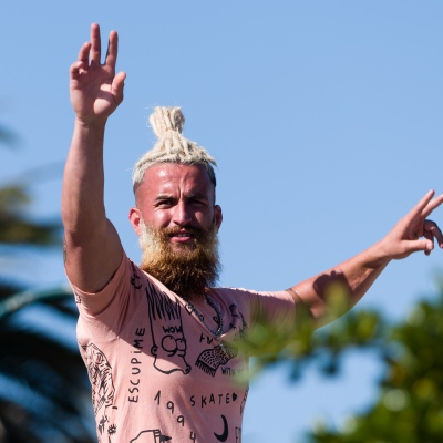 A man with a distinct hairstyle poses during COVID-19 in St Kilda Beach, Australia. Despite desperate attempts by the Premier to renew his COVID fear, thousands of Melbournians enjoy the sun at St Kilda Beach. A total of only 39 active cases currently exist in Victoria, despite this, Victorians currently in Queensland and NSW are being prevented from coming home. Zero new cases were discovered in Victoria today.  during COVID-19 in Victoria, Australia. Despite desperate attempts by the Premier to renew his COVID fear, thousands of Melbournians enjoy the sun at St Kilda Beach. A total of only 39 active cases currently exist in Victoria, despite this, Victorians currently in Queensland and NSW are being prevented from coming home. Zero new cases were discovered in Victoria today.