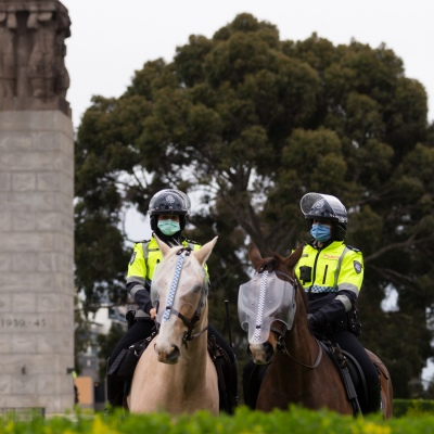 MELBOURNE, VIC - SEPTEMBER 12: Mounted Police stand ready for a would be protest during the Melbourne Freedom Walk Rally on September 12, 2020 in Melbourne, Australia. Stage 4 restrictions are in place from 6pm on Sunday 2 August for metropolitan Melbourne. This includes a curfew from 8pm to 5am every evening. During this time people are only allowed to leave their house for work, and essential health, care or safety reasons. Despite this, multiple protests are being arranged to push back against the draconian restrictions in place within metropolitan Melbourne. A Freedom Walk was arranged to take place in the Tan but with hundreds of police and wet weather forecast, only a small number of protesters tried to attend before being ordered to move on. (Photo by Speed Media/Icon Sportswire)
