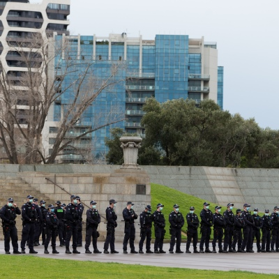 MELBOURNE, VIC - SEPTEMBER 12: A huge police presence is seen at the Shrine during the Melbourne Freedom Walk Rally on September 12, 2020 in Melbourne, Australia. Stage 4 restrictions are in place from 6pm on Sunday 2 August for metropolitan Melbourne. This includes a curfew from 8pm to 5am every evening. During this time people are only allowed to leave their house for work, and essential health, care or safety reasons. Despite this, multiple protests are being arranged to push back against the draconian restrictions in place within metropolitan Melbourne. A Freedom Walk was arranged to take place in the Tan but with hundreds of police and wet weather forecast, only a small number of protesters tried to attend before being ordered to move on. (Photo by Speed Media/Icon Sportswire)