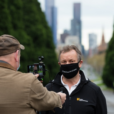 MELBOURNE, VIC - SEPTEMBER 12: A man who claims to be a local, wearing an anti Daniel Andrews facemask stops to speak to the media before being arrested during the Melbourne Freedom Walk Rally on September 12, 2020 in Melbourne, Australia. Stage 4 restrictions are in place from 6pm on Sunday 2 August for metropolitan Melbourne. This includes a curfew from 8pm to 5am every evening. During this time people are only allowed to leave their house for work, and essential health, care or safety reasons. Despite this, multiple protests are being arranged to push back against the draconian restrictions in place within metropolitan Melbourne. A Freedom Walk was arranged to take place in the Tan but with hundreds of police and wet weather forecast, only a small number of protesters tried to attend before being ordered to move on. (Photo by Speed Media/Icon Sportswire)