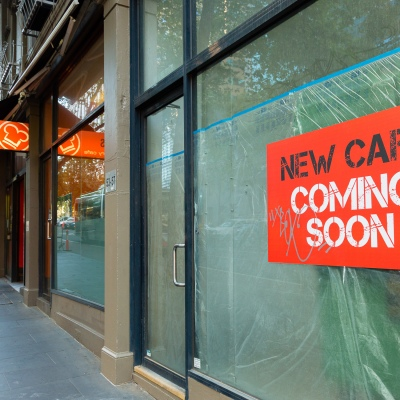 A stark reminder of the days before the virus hit. A sign prompting the opening of a new cafe gathers dust due to COVID 19 on 09 April, 2020 in Melbourne, Australia. (Photo by Speed Media/Icon Sportswire)