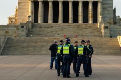 MELBOURNE, AUSTRALIA - APRIL 25: Police Officers look on as the dawn service was held at the Shrine of Remembrance with only 50 members of the public attending during COVID 19 on ANZAC Day 25 April, 2020 in Melbourne, Australia. (Photo by Speed Media/Icon Sportswire)