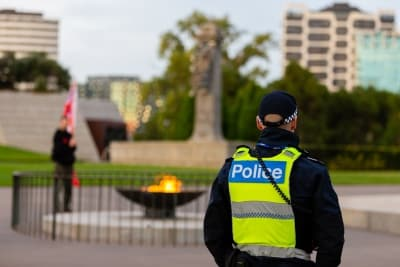 MELBOURNE, AUSTRALIA - APRIL 25: A Police Officer looks towards the Eternal Flame after the dawn service was held at the Shrine of Remembrance with only 50 members of the public attending during COVID 19 on ANZAC Day 25 April, 2020 in Melbourne, Australia. (Photo by Speed Media/Icon Sportswire)