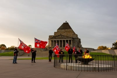 MELBOURNE, AUSTRALIA - APRIL 25: Members of the Australian Sovereign Counsel stand holding Australia's Red Ensign in front of the Shrine of Remembrance shortly after the dawn service during COVID 19 on ANZAC Day 25 April, 2020 in Melbourne, Australia. (Photo by Speed Media/Icon Sportswire)