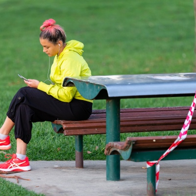MELBOURNE, AUSTRALIA - APRIL 27: A women sits on a park bench which has been taped of due to COVID 19 on 27 April, 2020 in Melbourne, Australia. (Photo by Speed Media/Icon Sportswire)