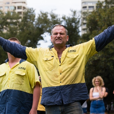 A man is seen revving up protesters during a protest in response to mandatory COVID-19 vaccinations at Fawkner Park on February 20, 2021 in Melbourne, Victoria Australia. Up to 680,000 people are set to receive the first lot of Pfizer/BioNTech vaccinations. Hotel quarantine, health hotel workers, airport and port workers, high-risk frontline health staff and public sector residential aged care staff and residents will be the first under Phase 1A of the roll-out plan.