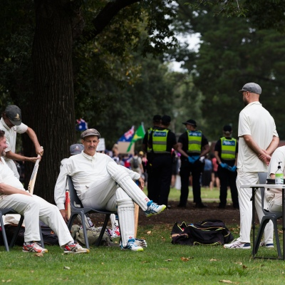 Protesters disrupt a cricket game during a protest in response to mandatory COVID-19 vaccinations at Fawkner Park on February 20, 2021 in Melbourne, Victoria Australia. Up to 680,000 people are set to receive the first lot of Pfizer/BioNTech vaccinations. Hotel quarantine, health hotel workers, airport and port workers, high-risk frontline health staff and public sector residential aged care staff and residents will be the first under Phase 1A of the roll-out plan.