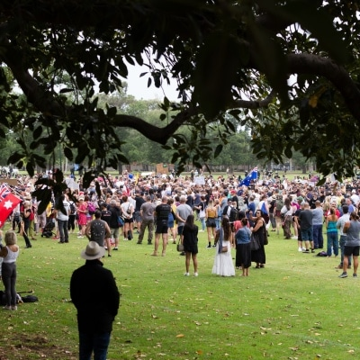 Thousands of protesters are seen during a protest in response to mandatory COVID-19 vaccinations at Fawkner Park on February 20, 2021 in Melbourne, Victoria Australia. Up to 680,000 people are set to receive the first lot of Pfizer/BioNTech vaccinations. Hotel quarantine, health hotel workers, airport and port workers, high-risk frontline health staff and public sector residential aged care staff and residents will be the first under Phase 1A of the roll-out plan.