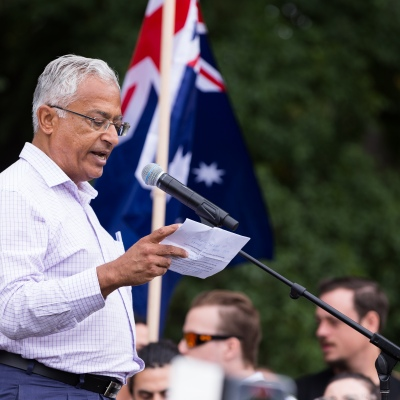 Sanjeev Sabhlok, a Victorian Treasury economist with 18 years of service resigned in disgust over the behavior of the Danial Andrews State Government is seen speaking to protesters during a protest in response to mandatory COVID-19 vaccinations at Fawkner Park on February 20, 2021 in Melbourne, Victoria Australia. Up to 680,000 people are set to receive the first lot of Pfizer/BioNTech vaccinations. Hotel quarantine, health hotel workers, airport and port workers, high-risk frontline health staff and public sector residential aged care staff and residents will be the first under Phase 1A of the roll-out plan.