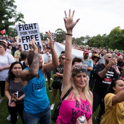 Thousands of protesters are seen cheering during a protest in response to mandatory COVID-19 vaccinations at Fawkner Park on February 20, 2021 in Melbourne, Victoria Australia. Up to 680,000 people are set to receive the first lot of Pfizer/BioNTech vaccinations. Hotel quarantine, health hotel workers, airport and port workers, high-risk frontline health staff and public sector residential aged care staff and residents will be the first under Phase 1A of the roll-out plan.