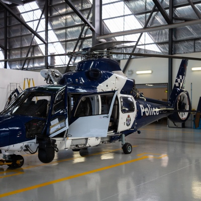 MELBOURNE, AUSTRALIA - JULY 1: A police helicopter waits for maintenance on 1 July, 2020 in Melbourne, Australia. The Police Air Wing was called in to rescue four trapped walkers in Glenaire about 10pm last night and in 75 km/h winds. Officers were told two men, both aged 73, and two women, aged 51 and 49, had been walking from Castle Cove along Great Ocean Walk to Dinosaur Cove when they were forced to the waters edge by a scrub fire. The group attempted to reach Johanna Beach but were trapped on a rock ledge by the rising tide They managed to contact emergency services just before 7pm and the Air Wing was dispatched. On arrival officers used night vision goggles and a winch to rescue the group. A man and women in the walking party were showing the initial signs of hypothermia and were taken to a waiting ambulance. The other members of the group were not injured. (Photo by Speed Media/Icon Sportswire)