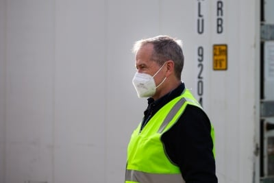 MELBOURNE, AUSTRALIA - JULY 10: Bill Shorten (left) is seen wearing a facemask in the main staging area near the Alfred Street housing commission tower as they remain locked down during COVID 19 on 10 July, 2020 in Melbourne, Australia. Former Federal Labor Leader Bill Shorten, along with close allies at Trades Hall help deliver Halal meat, supplied by Macca Halal Foods to the locked down housing commission towers following a COVID-19 outbreak detected inside the complex. Mr Shorten was able to use his high profile to ensure food was not turned away by police so that it would reach the residents inside. (Photo by Speed Media/Icon Sportswire)