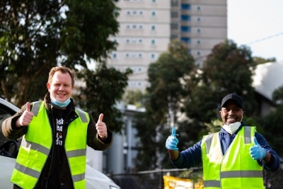 MELBOURNE, AUSTRALIA - JULY 10: Victorian Trades Hall Council Secretary, Luke Hilakari (left) and owner of Macca Halal Foods, Abukar Hersi (right) pose for the camera as they finish unloading a truck full of donated halal meat for the Alfred Street residents who are still the subject of a hard lockdown during COVID 19 on 10 July, 2020 in Melbourne, Australia. Former Federal Labor Leader Bill Shorten, along with close allies at Trades Hall help deliver Halal meat, supplied by Macca Halal Foods to the locked down housing commission towers following a COVID-19 outbreak detected inside the complex. Mr Shorten was able to use his high profile to ensure food was not turned away by police so that it would reach the residents inside. (Photo by Speed Media/Icon Sportswire)