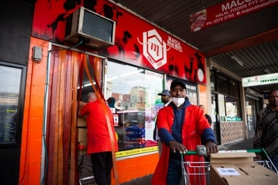 MELBOURNE, AUSTRALIA - JULY 10: The owner of Macca Halal Meats, Abukar Hersi (Cullusow) (R) is seen helping load a truck with much needed meat for the residents of the locked down housing commission towers during COVID 19 on 10 July, 2020 in Melbourne, Australia. Former Federal Labor Leader Bill Shorten, along with close allies at Trades Hall help deliver Halal meat, supplied by Macca Halal Foods to the locked down housing commission towers following a COVID-19 outbreak detected inside the complex. Mr Shorten was able to use his high profile to ensure food was not turned away by police so that it would reach the residents inside. (Photo by Speed Media/Icon Sportswire)