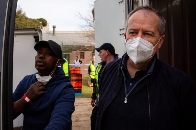 MELBOURNE, AUSTRALIA - JULY 10: Former Federal Labor Leader Bill Shorten (right) is seen preparing to unload a truck full of halal meat in the main staging area outside of the remaining locked down tower at Alfred Street as he helps deliver tons of meat to the residents during COVID 19 on 10 July, 2020 in Melbourne, Australia. Former Federal Labor Leader Bill Shorten, along with close allies at Trades Hall help deliver Halal meat, supplied by Macca Halal Foods to the locked down housing commission towers following a COVID-19 outbreak detected inside the complex. Mr Shorten was able to use his high profile to ensure food was not turned away by police so that it would reach the residents inside. (Photo by Speed Media/Icon Sportswire)
