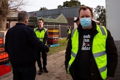 MELBOURNE, AUSTRALIA - JULY 10: Secretary of the Trades Hall Council, Luke Hilikari (right) is seen with Bill Shorten (left) as they wait for a truck carrying halal meat for the residents during COVID 19 on 10 July, 2020 in Melbourne, Australia. Former Federal Labor Leader Bill Shorten, along with close allies at Trades Hall help deliver Halal meat, supplied by Macca Halal Foods to the locked down housing commission towers following a COVID-19 outbreak detected inside the complex. Mr Shorten was able to use his high profile to ensure food was not turned away by police so that it would reach the residents inside. (Photo by Speed Media/Icon Sportswire)