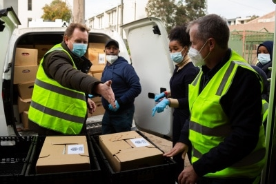 MELBOURNE, AUSTRALIA - JULY 10: Luke Hilakari (left), Secretary of Trades Hall coordinates the delivery of much needed halal meat as Bill Shorten (right) helps unload boxes of food into a freezer during COVID 19 on 10 July, 2020 in Melbourne, Australia. Former Federal Labor Leader Bill Shorten, along with close allies at Trades Hall help deliver Halal meat, supplied by Macca Halal Foods to the locked down housing commission towers following a COVID-19 outbreak detected inside the complex. Mr Shorten was able to use his high profile to ensure food was not turned away by police so that it would reach the residents inside. (Photo by Speed Media/Icon Sportswire)