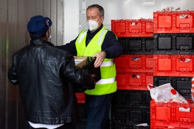 MELBOURNE, AUSTRALIA - JULY 10: Bill Shorten (right) is seen inside a large freezer as he helps unload a truck full of meat from Macca Halal Foods for the residents of the Alfred Street housing commission tower during COVID 19 on 10 July, 2020 in Melbourne, Australia. Former Federal Labor Leader Bill Shorten, along with close allies at Trades Hall help deliver Halal meat, supplied by Macca Halal Foods to the locked down housing commission towers following a COVID-19 outbreak detected inside the complex. Mr Shorten was able to use his high profile to ensure food was not turned away by police so that it would reach the residents inside. (Photo by Speed Media/Icon Sportswire)