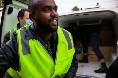 MELBOURNE, AUSTRALIA - JULY 10: Islamic Council of Victoria and Tower resident, Mukhtar Mohammed unloads a truck filled with meat for the residents still affected by the remaining locked down housing commission tower during COVID 19 on 10 July, 2020 in Melbourne, Australia. Former Federal Labor Leader Bill Shorten, along with close allies at Trades Hall help deliver Halal meat, supplied by Macca Halal Foods to the locked down housing commission towers following a COVID-19 outbreak detected inside the complex. Mr Shorten was able to use his high profile to ensure food was not turned away by police so that it would reach the residents inside. (Photo by Speed Media/Icon Sportswire)