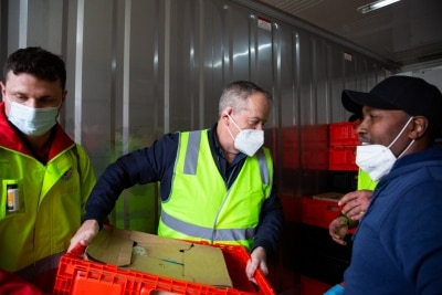 MELBOURNE, AUSTRALIA - JULY 10: Former Labor Leader Bill Shorten (centre) is seen unloading a truck full of halal meat for the residents affected in the Alfred Street tower which is still under hard lockdown during COVID 19 on 10 July, 2020 in Melbourne, Australia. Former Federal Labor Leader Bill Shorten, along with close allies at Trades Hall help deliver Halal meat, supplied by Macca Halal Foods to the locked down housing commission towers following a COVID-19 outbreak detected inside the complex. Mr Shorten was able to use his high profile to ensure food was not turned away by police so that it would reach the residents inside. (Photo by Speed Media/Icon Sportswire)